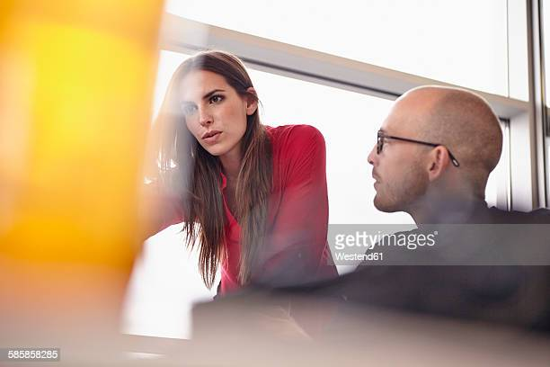 Man and woman working at desk in office