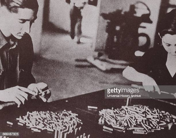 Man and woman working in a republican munitions factory during the Spanish Civil War