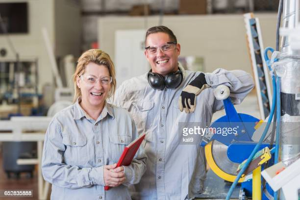 Man and woman working in shutter factory