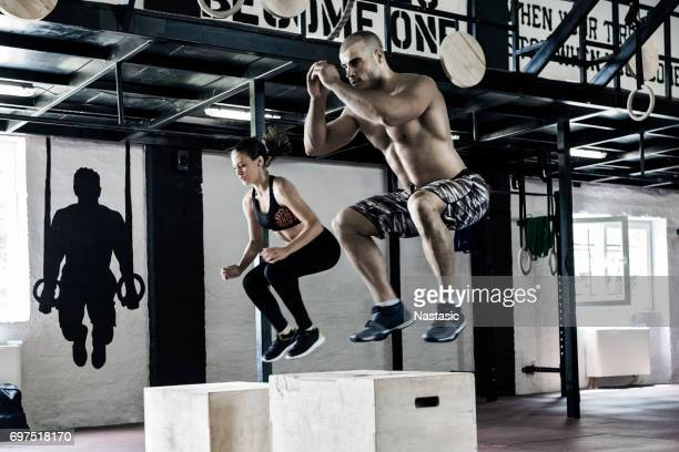 man and woman working out - crossfit stock pictures, royalty-free photos & images