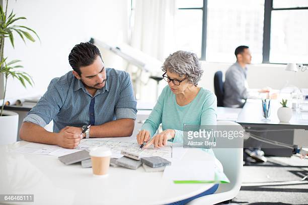 Man and woman working together in an office