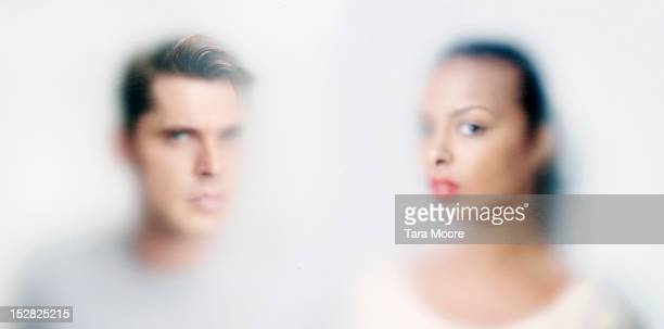 man and woman's face obscured behind glass - defocussed stock pictures, royalty-free photos & images