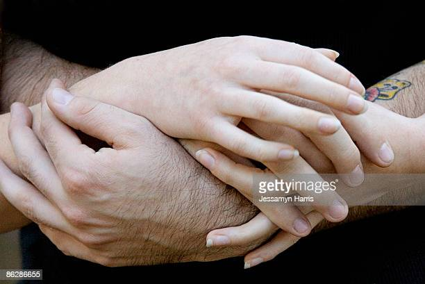 man and woman's hands - jessamyn harris stock pictures, royalty-free photos & images