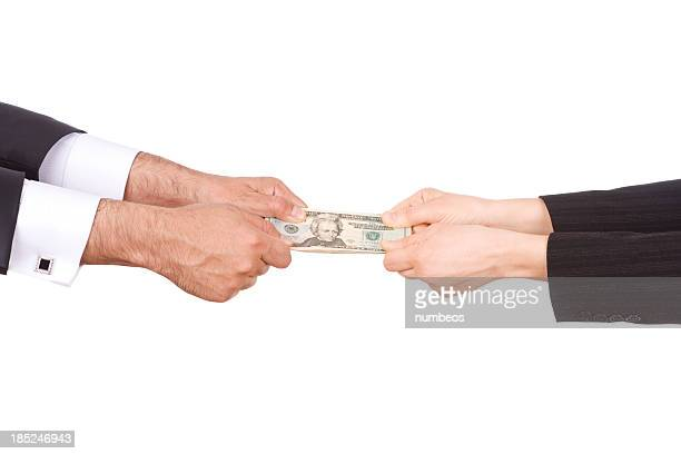 Man and woman's hands pulling on ends of twenty dollar bill