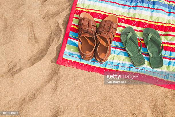 Man and woman's sandals on beach