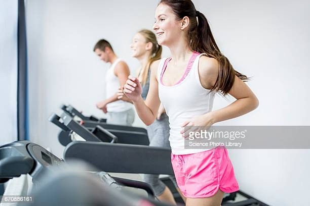 Man and women exercising in gym
