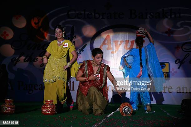 Man and Women Performing a traditional dance in Delhi on Saturday April 14 on Baisakhi Festival in New Delhi India