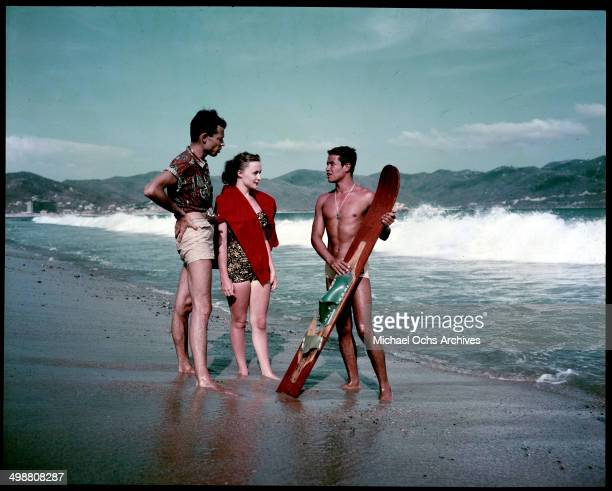 A man and women talk to a local skier on the beach in Acapulco Mexico in July 1953