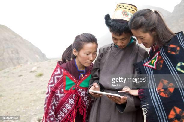 Man and women using digital tablet