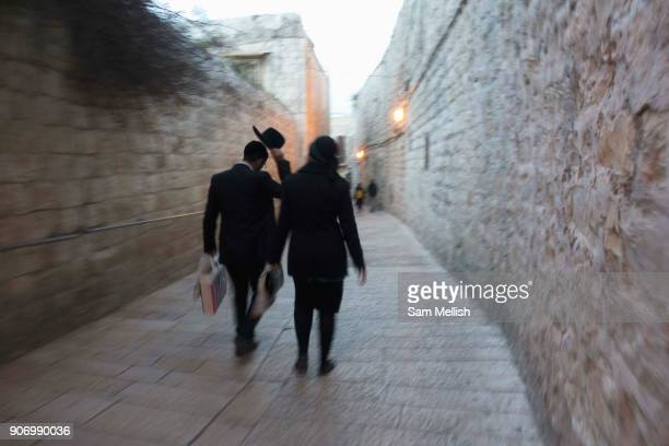 A man and women walk along a street in the Old City of Jerusalem on 30th March 2016 in Jerusalem West Bank