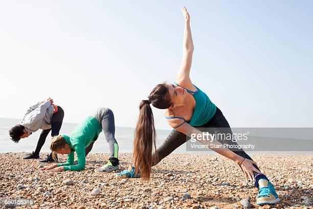Man and women warm up training on Brighton beach