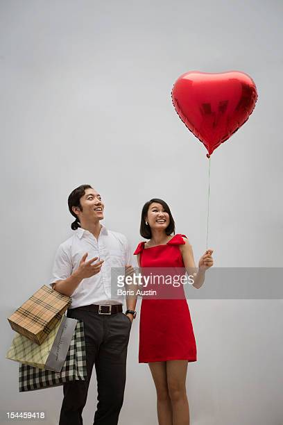 Man and women with heart balloon