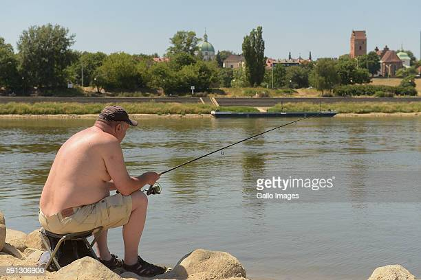 A man angles on the bank of the Vistula river July 6 2015 in Warsaw Poland