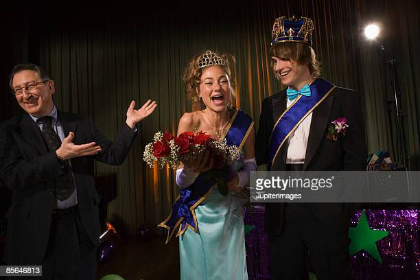 man announcing prom king and prom queen - sash stock pictures, royalty-free photos & images