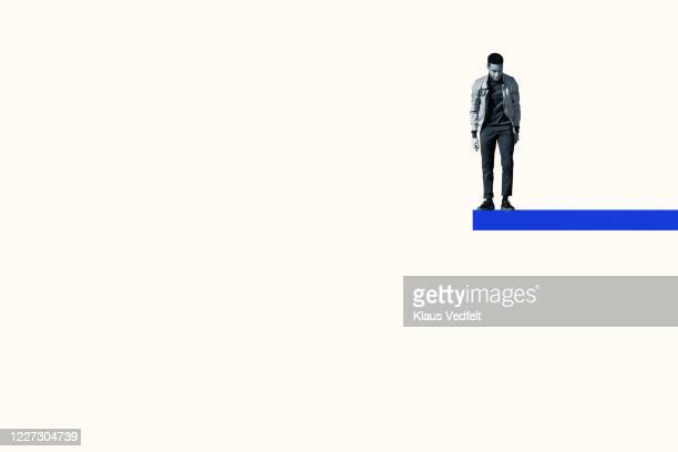man anticipating while standing on blue ramp - suicide stock pictures, royalty-free photos & images