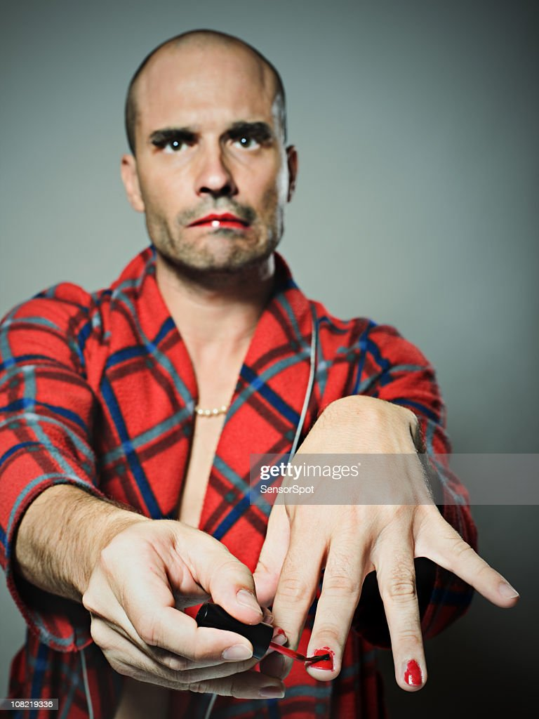 Man Applying Red Nail Polish Stock Photo | Getty Images