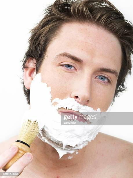 man applying shaving cream - shaving brush stock photos and pictures