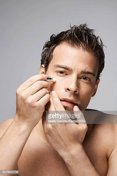 Man applying wrinkle cream