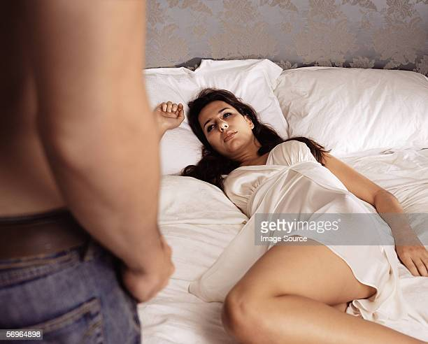 Man approaching woman in bed