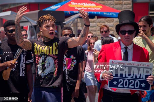 A man argues at Trump supporter Gregg Donovan as workers replace the Hollywood Walk of Fame Star of President Donald J Trump on the Hollywood Walk of...