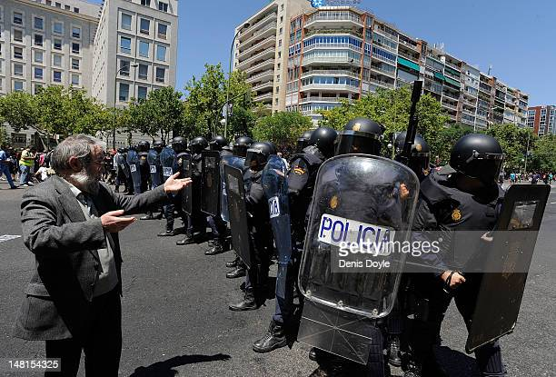 A man argues with riot police after trouble broke out during a demonstration by Spanish coal miners on July 11 2012 in Madrid Spain The miners had...