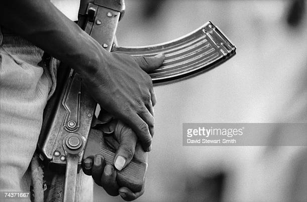A man armed with an AK47 assault rifle in Kabro village in the Nuba Mountains of Kordofan in central Sudan 8th November 1995