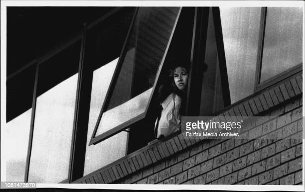 A man armed with explosiveA Hostage looks from a window of the office block before being released***** and a sawnoff rife and accompanied by his wife...