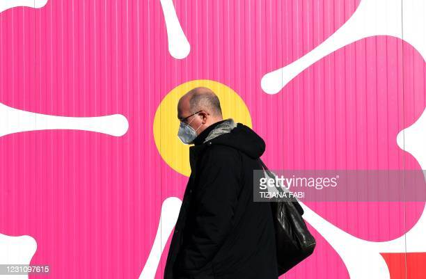Man arrives at a hub for Covid-19 vaccinations located in Rome's Fiumicino airport long-term parking area on February 11, 2021 at the start of a...