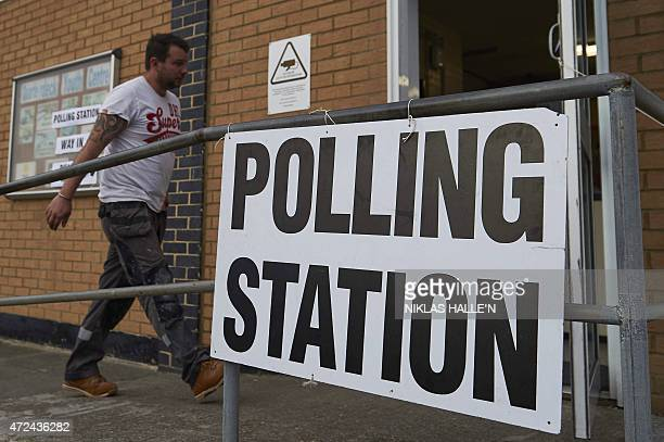 A man arrives at a polling station in Margate southeast England on May 7 2015 to vote as Britain holds a general election Polls opened in Britain's...