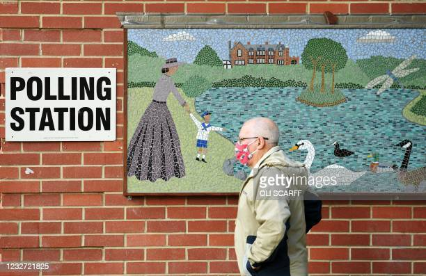 Man arrives at a polling station set up at a bowls pavillion in Hartlepool to cast a vote in local elections on May 6, 2021. - Britain heads to the...