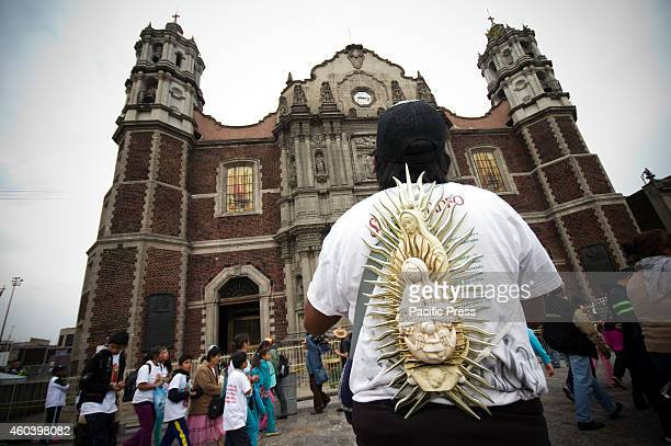 A man arrives at the old Basilica of Our Lady of Guadalupe after a long journey The Basilica of Our Lady of Guadalupe in Mexico City is one of most...