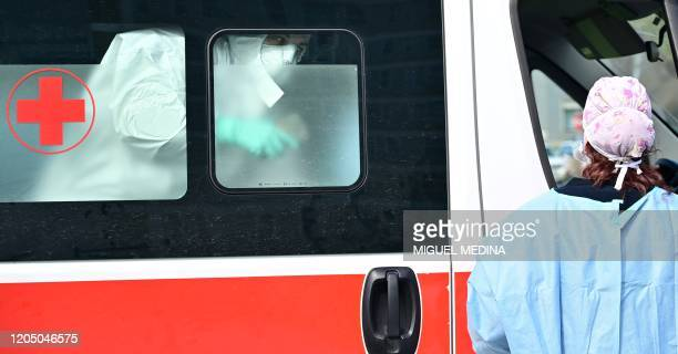 Man arrives in an ambulance at the a pre-triage medical tent in front of the Cremona hospital, in Cremona, northern Italy, on March 4, 2020. - Italy...