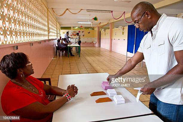 A man arrives in the polling station of Cayenne on the French South American territory of Guiana on January 10 for the referendum on the status and...