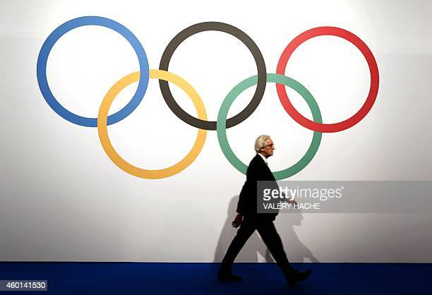 A man arrives on December 8 2014 for the 127th International Olympic Committee extraordinary session in Monaco The IOC on December 8 voted to allow...