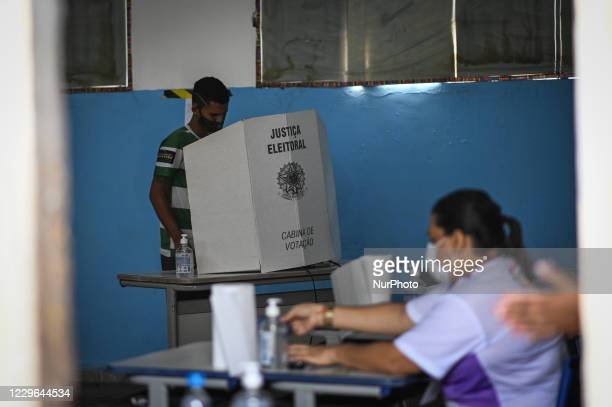 Man arrives to vote at a polling booth during municipal elections amid the Coronavirus pandemic in Santana, Amapá State, Brazil, on November 15,...