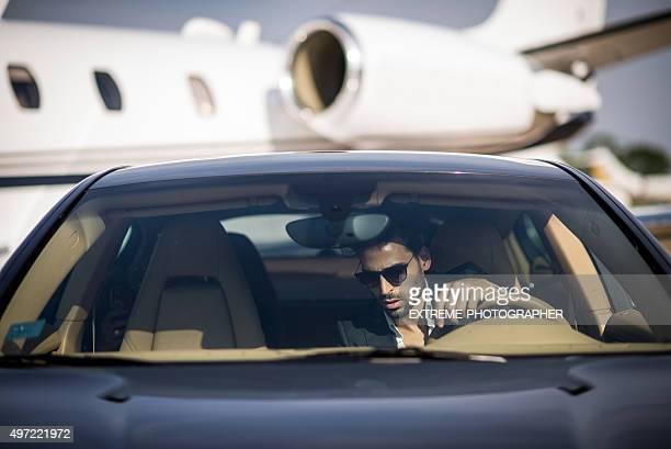 Man arriving at the airport by car