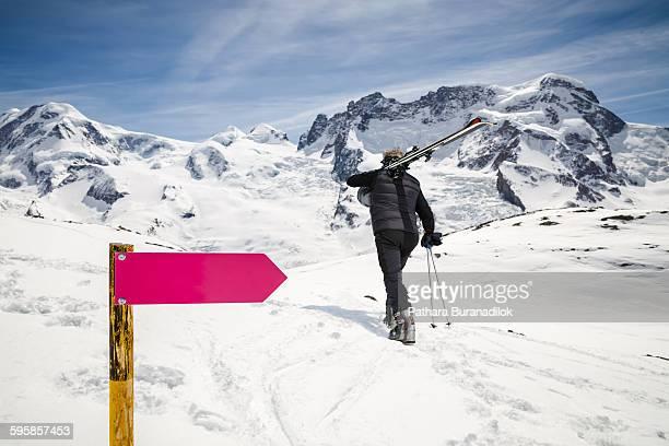 A man arrying a ski equipment
