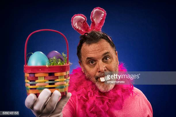 Man as Deranged Easter Bunny offering basket