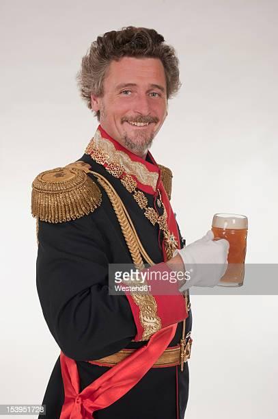 Man as King Ludwig of Bavaria with beer mug, portrait