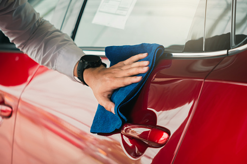 Man asian inspection and cleaning Equipment car wash With red car For cleaning to quality to customer on car showroom of service transport automobile transportation automotive image. 1151363060