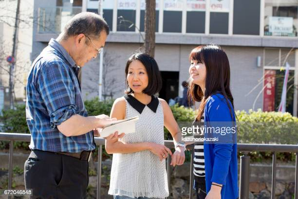 a man asks a course - ミッドアダルト stock pictures, royalty-free photos & images