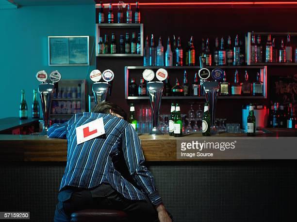 man asleep at bar - unconscious stock pictures, royalty-free photos & images
