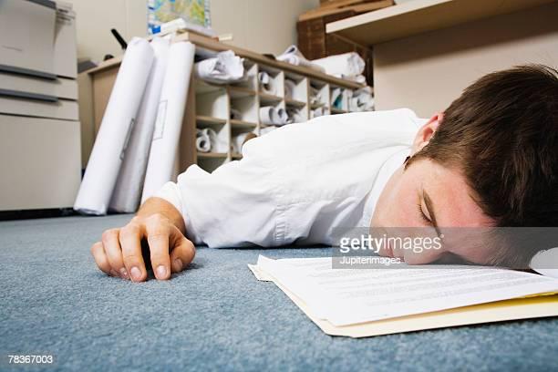 Man asleep on office floor
