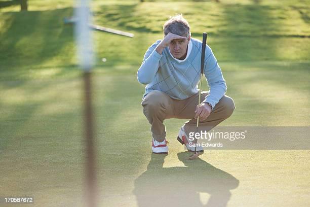 man assessing play on golf course - puttning bildbanksfoton och bilder