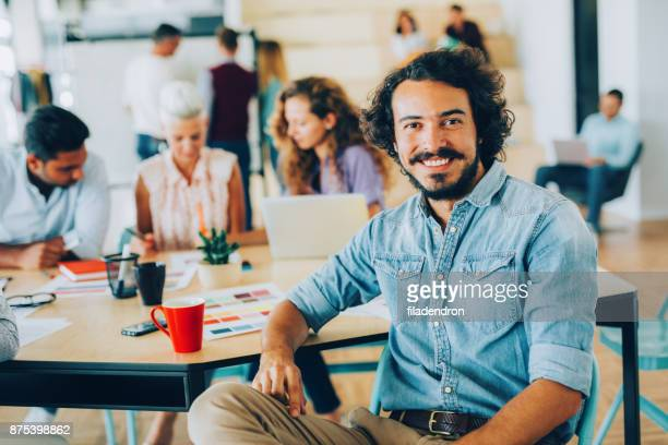 man at a business meeting - satisfaction stock pictures, royalty-free photos & images