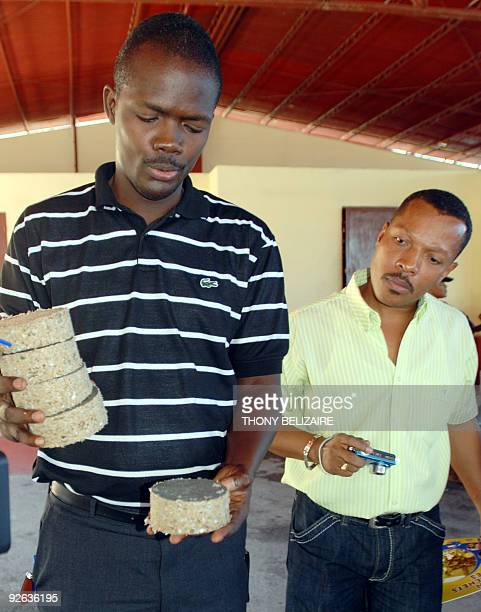 A man at a factory on October 30 checks transformed industrial waste consisting of paper and domestic trash which is made into bricks to replace...