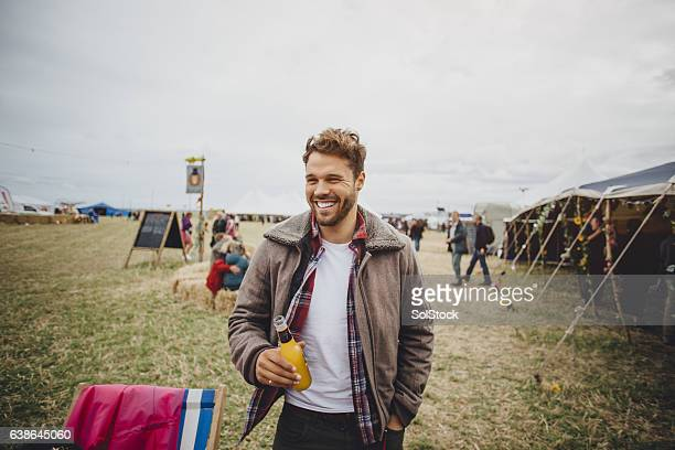 man at a festival - music festival stock pictures, royalty-free photos & images