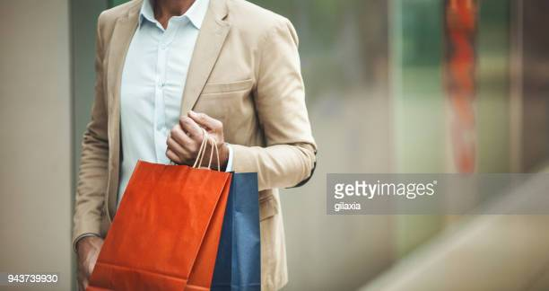 man at a shopping mall. - shopping bag stock pictures, royalty-free photos & images
