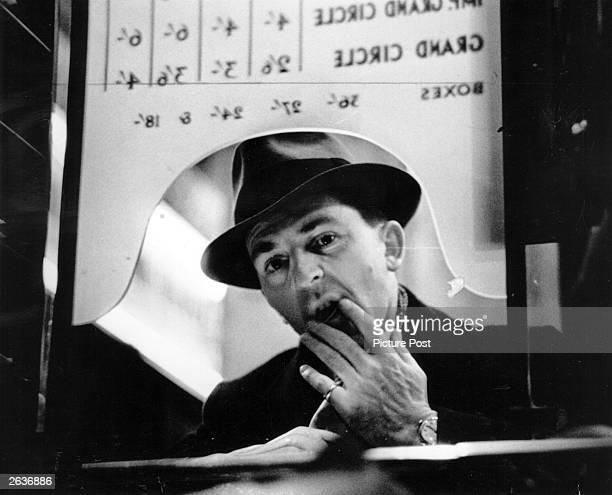 Man at a theatre box office. Original Publication: Picture Post - 126 - Box Office - pub. 1939