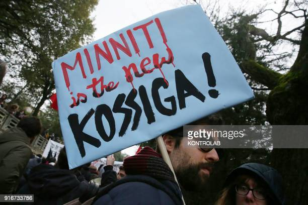 A man at antiracist demonstrations in Macerata with poster